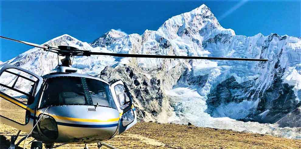 helicopter landing infront of Mount Everest in a luxury tour