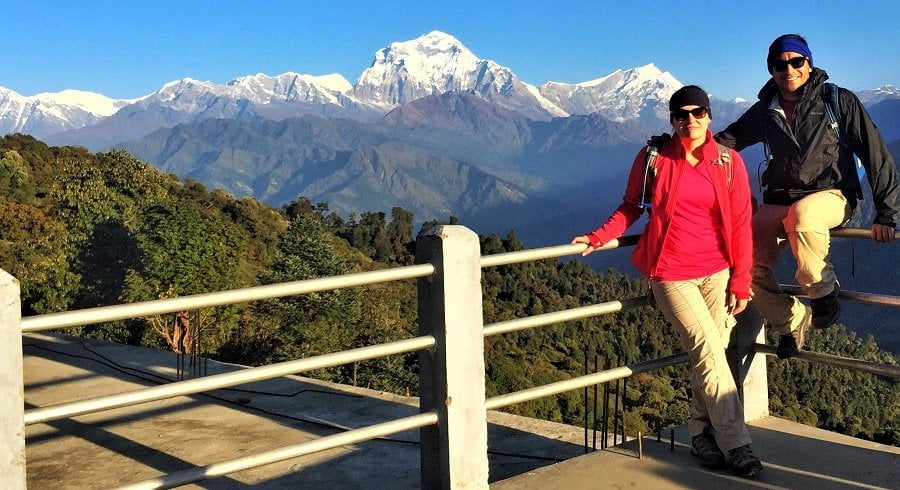 Couple at Ghorepani village with smile in front of the Mt Dhaulagiri