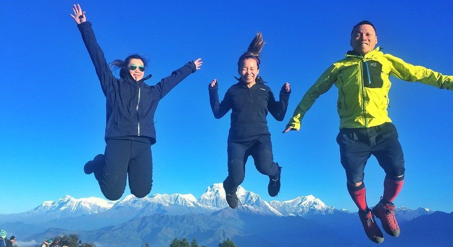 Happy trekkers jumping at the poonhill view point after getting back from Jomsom Muktinath trekking