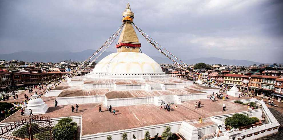 Boudhanath stupa seen in the evening from a restaurant rooftop on kathmandu 1 day tour lunch time