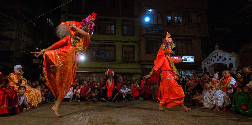 During the local festival - folks dancing with face mask and special dresses