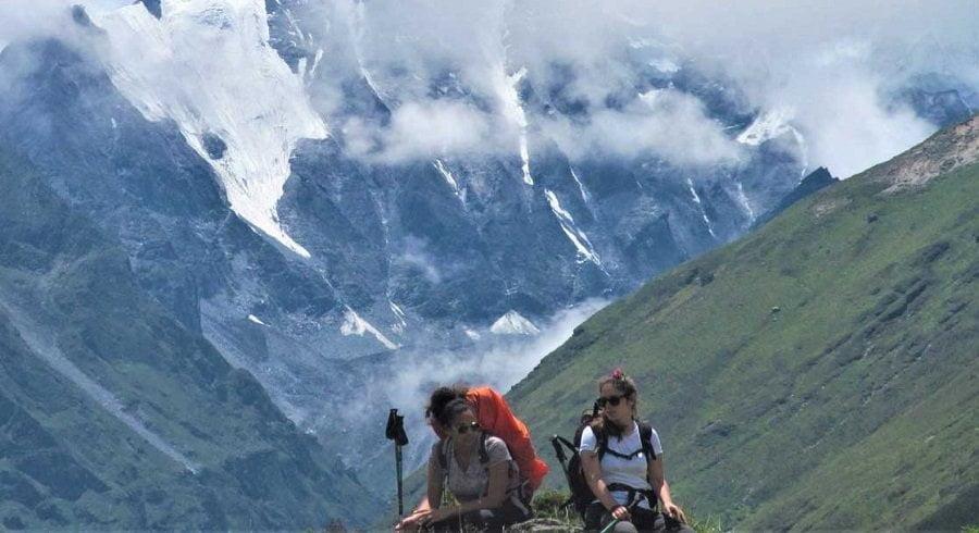 Girls taking break on their adventure trip in Nepal to Langtang Ganja la pass trek
