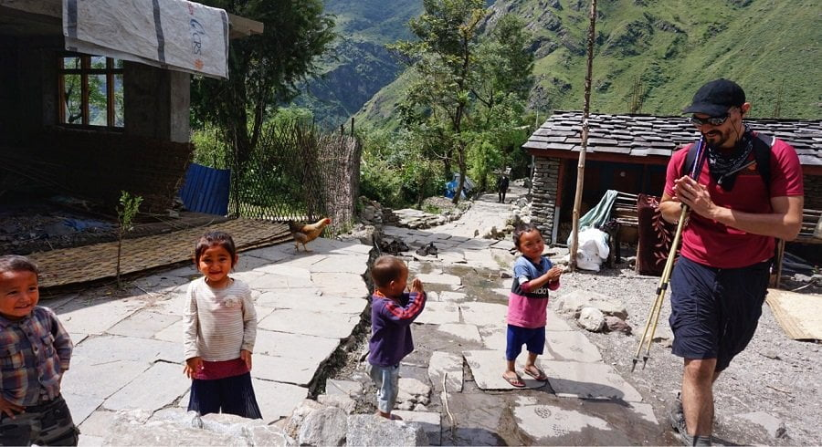 Kids greeting while trekking along the local villages