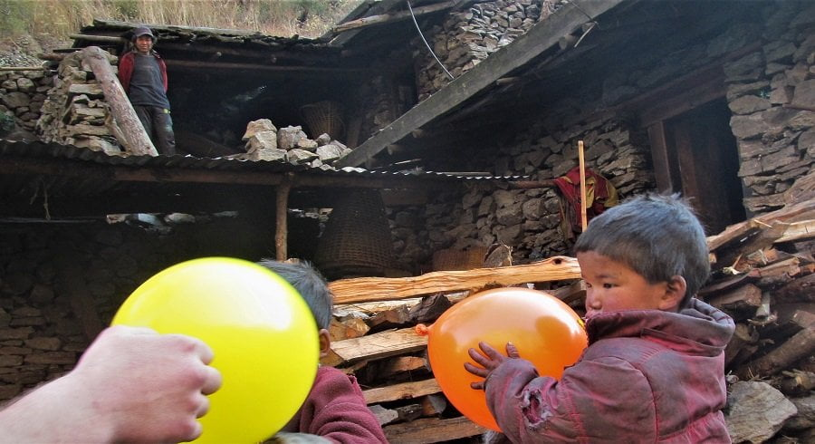 Happy tourist grumpy kid with balloon as their gift