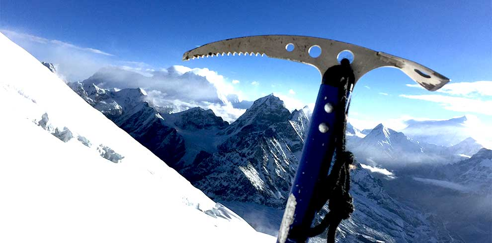 Ice axe pointing the Mount everest in Mera peak climbing trip