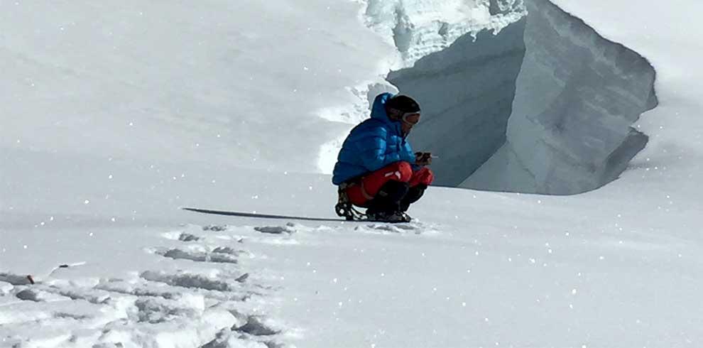 Mera peak climbing guide smoking near the sumit