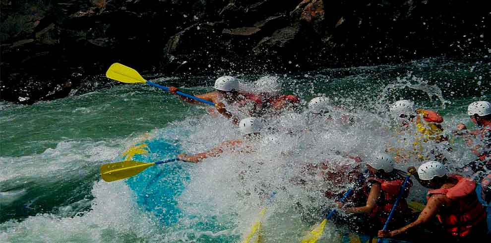 Nepal adventure tour participates enjoying the splash of water in trishuli river rafting
