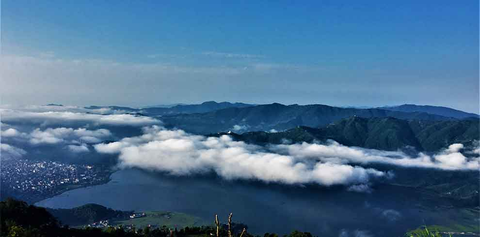 beauty of pokhara city, the lakes and the world peace stupa seen from sarangkot in Nepal chilling tour