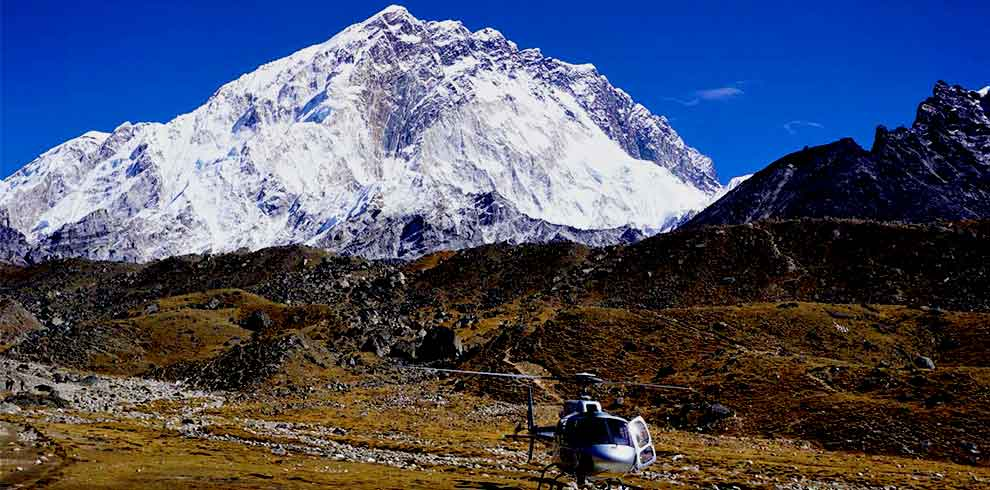 Helicopter refilling the gas infront of Mt Nuptse in our Everest nepal luxury tour