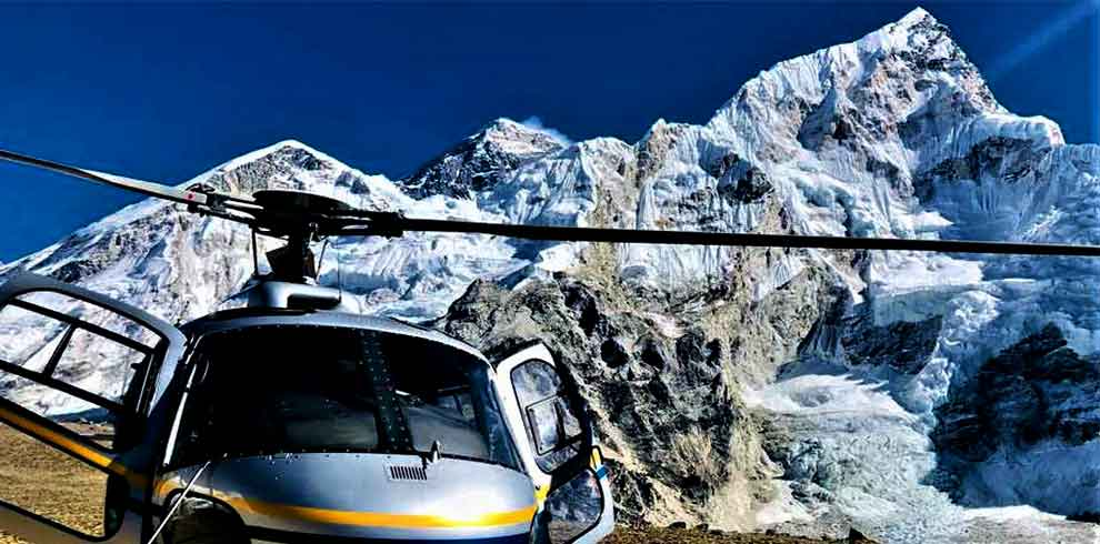 Helicopter infront of Everest while passengers are taking selfie with everest on their Nepal luxury tour