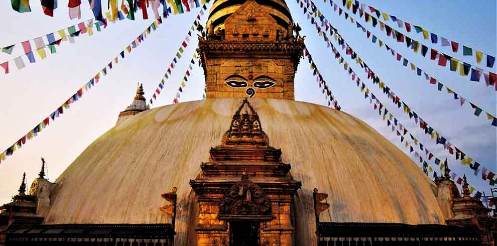 The eyes of Buddha at Swyambhunath stupa on a luxury tour in Nepal