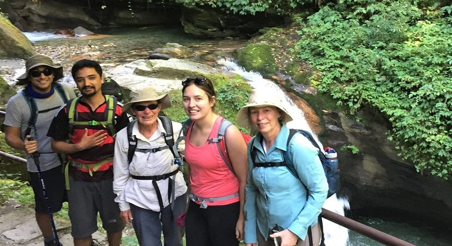 Near waterfall on family trek to Poon hill
