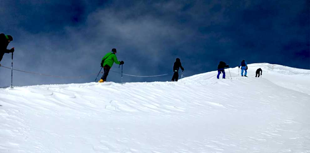 Climbers connected with rope on the way up to the summit of Tharpu chuli peak