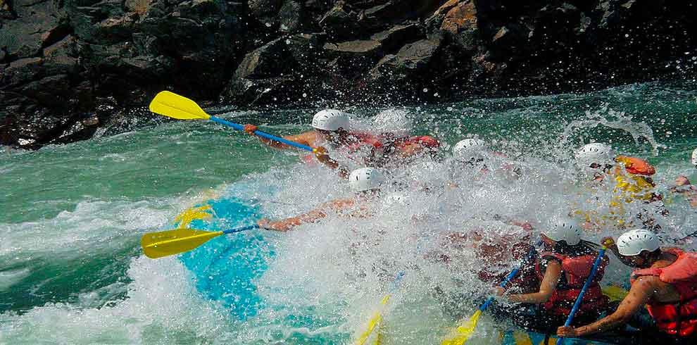 Clients of Nepalgram enjoying the splash of water while rafting in trishuli riverq