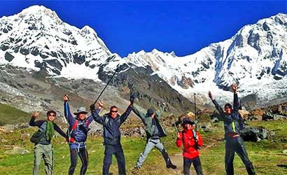 happy clients at annapurna basecamp on their Nepal travels joy