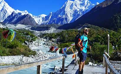 marcin watching Mt Manaslu from the bridge nearby Bhimtang village