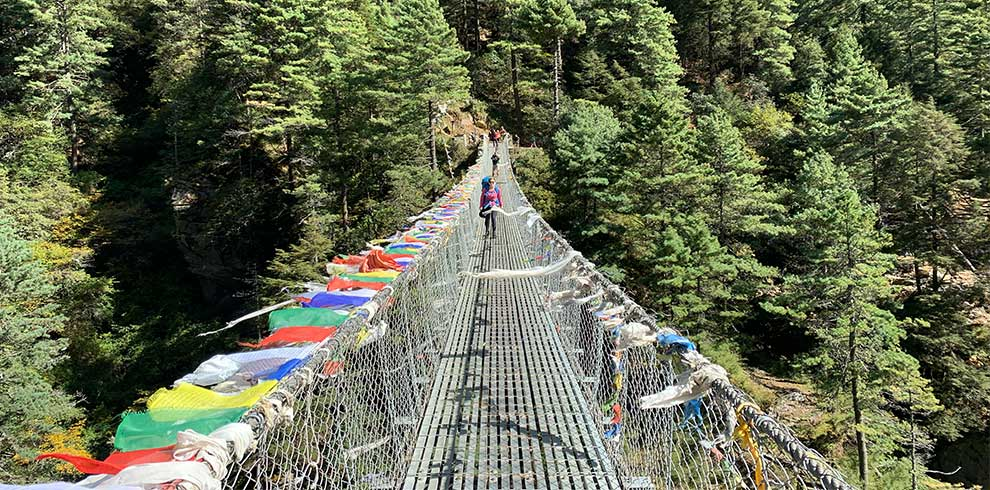 Beautiful bridge decorated with spiritual flags of Buddhism