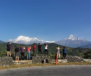 People taking vitamin d while looking at beautiful mountains on their way to ghandruk village