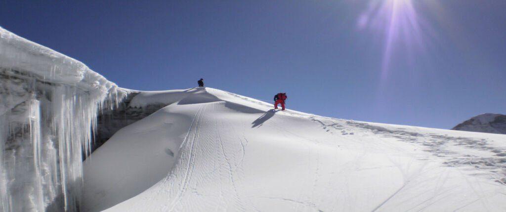 Climbers climbing to the summit of Pharchamo Peak